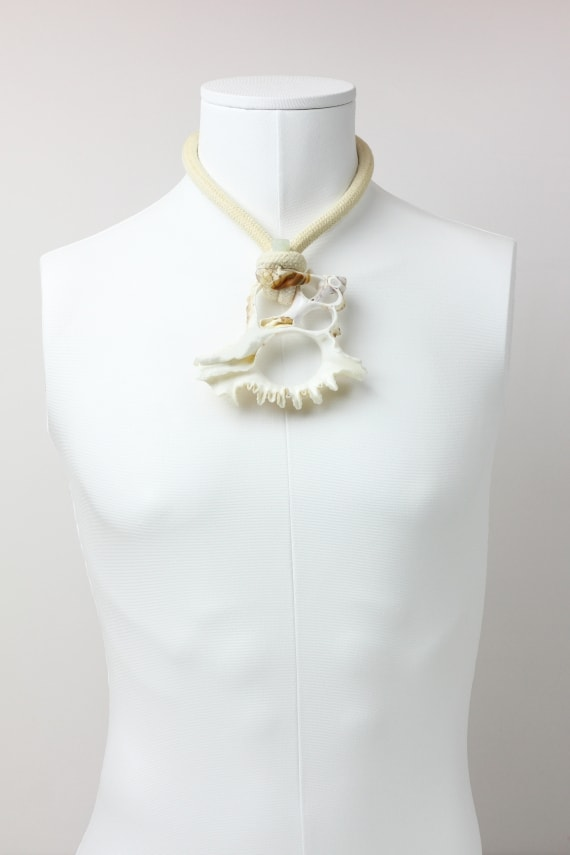 Conch shell necklace with jade skull
